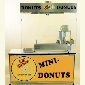 Lil' Orbits most popular package, featuring the SS1200 Mini Donut Machine and CE150 Deluxe Cabinet.