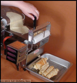 During the cooking process, you can add fillings to your crepes and watch them automatically roll up before they are deposited into a holding tray